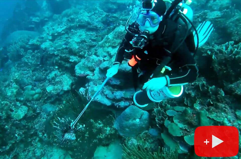 Roger J. Muller, Jr. with lionfish kill