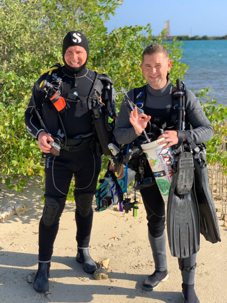 Roger J. Muller, Jr. and Jared Casperson prepare to dive for lionfish
