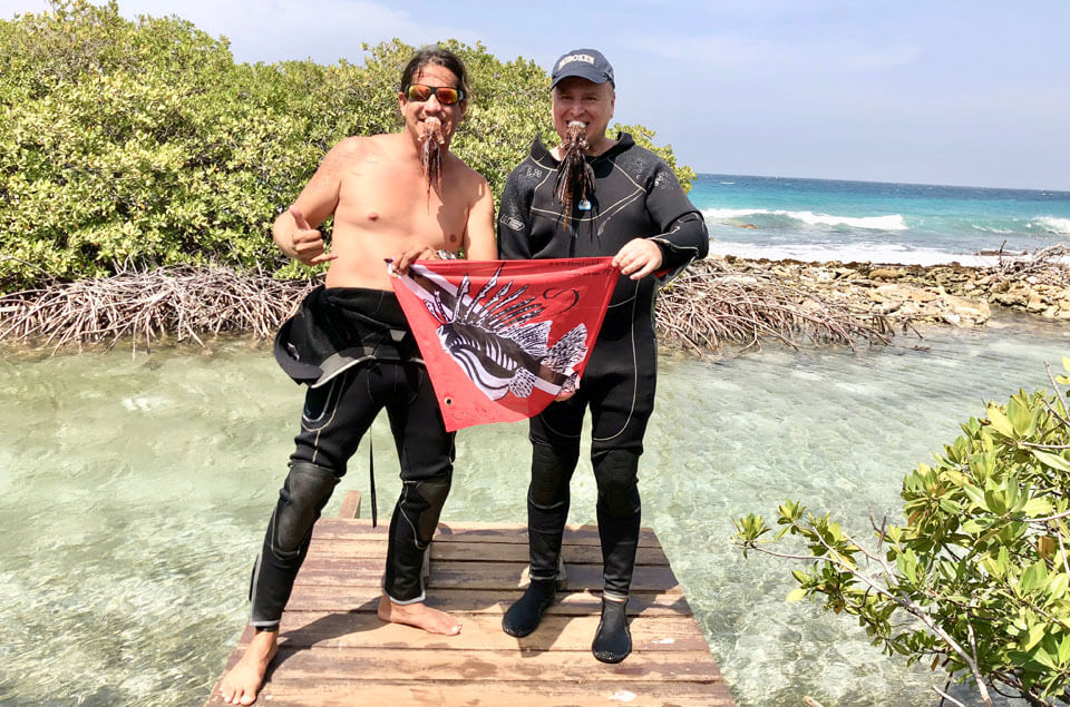 Norman Arends & Roger Muller with lionfish