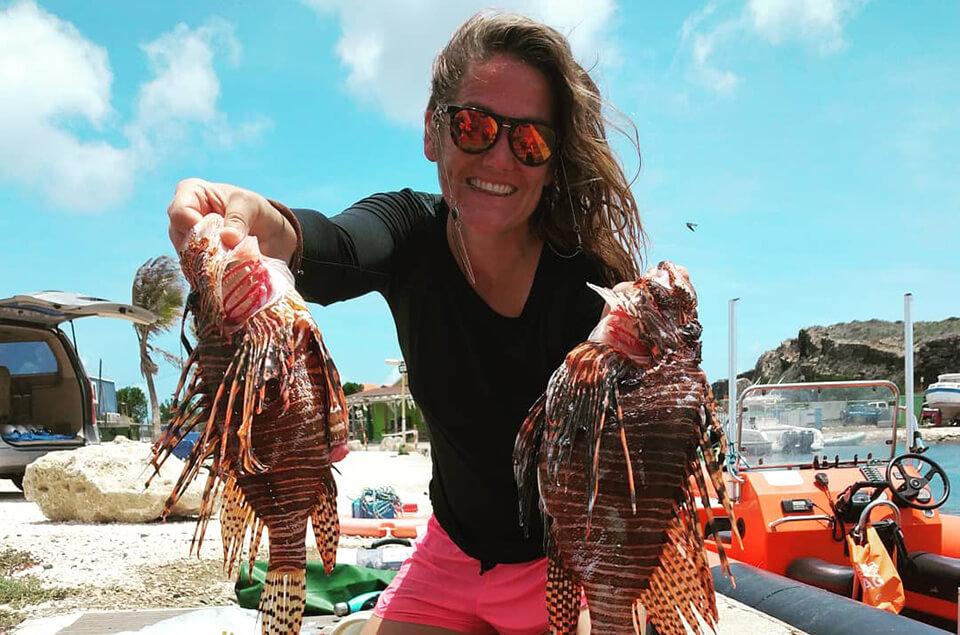 Lisette Keus holding lionfish