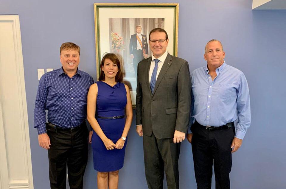 Roger J. Muller, Jr., Abigail Vrolijk, Governor Alfonso Boekhoudt, and Ed Egan