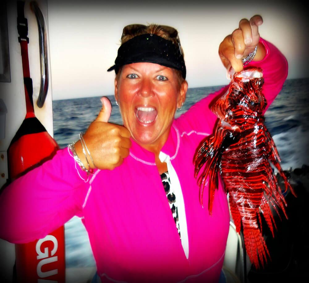 Dottie Benjamin holding a lionfish