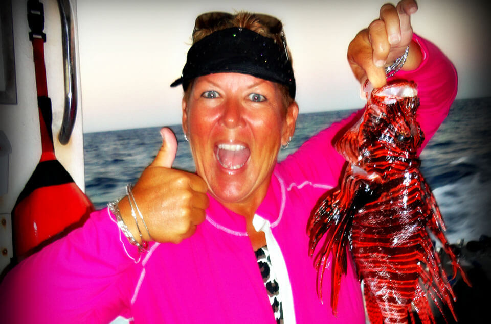 Dottie Benjamin holding a lionfish
