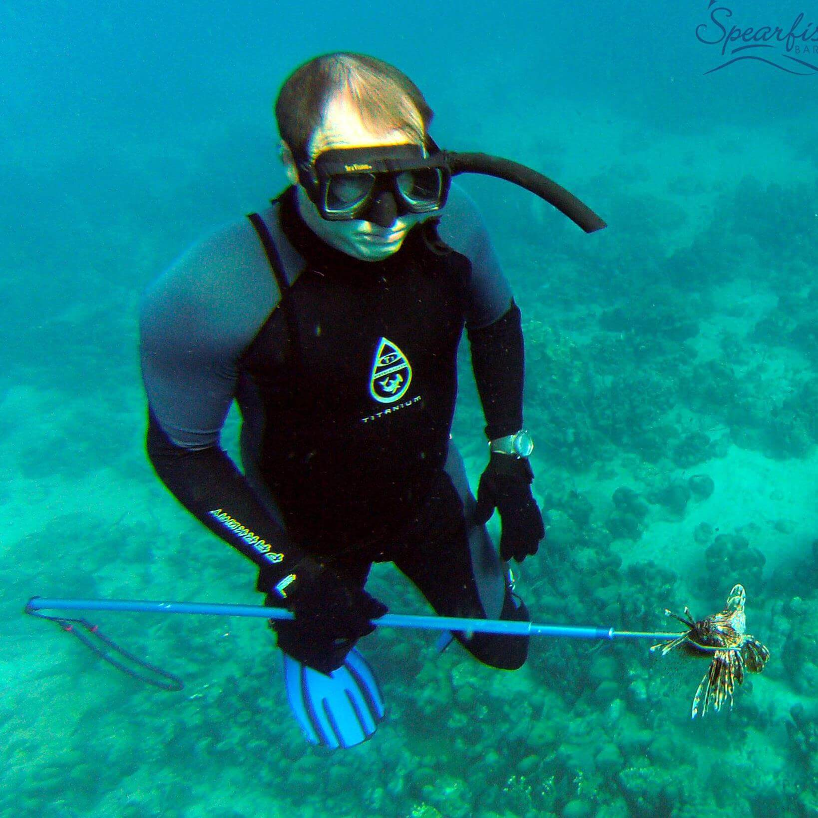 Andy Lowe spearing lionfish