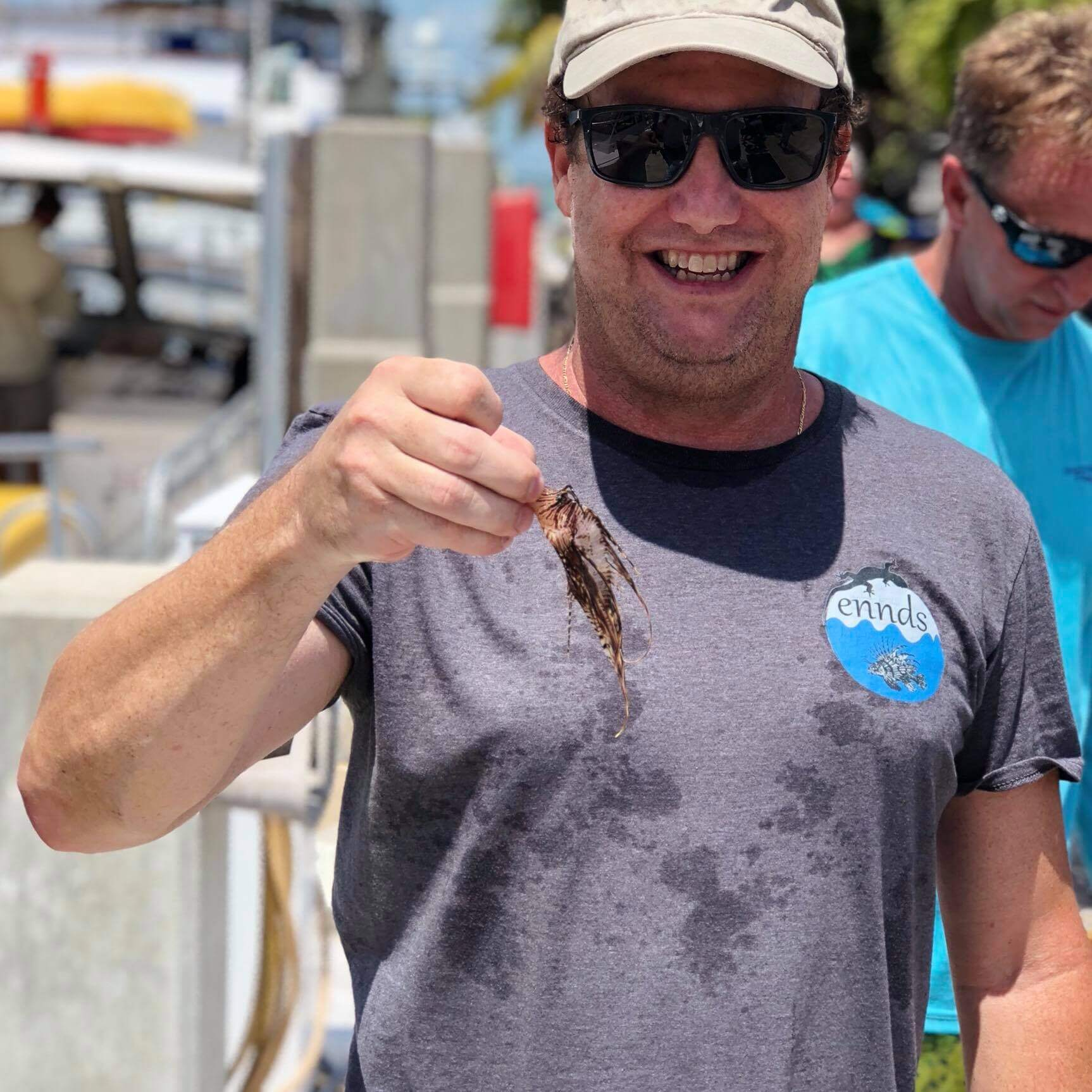Andy Lowe holding lionfish