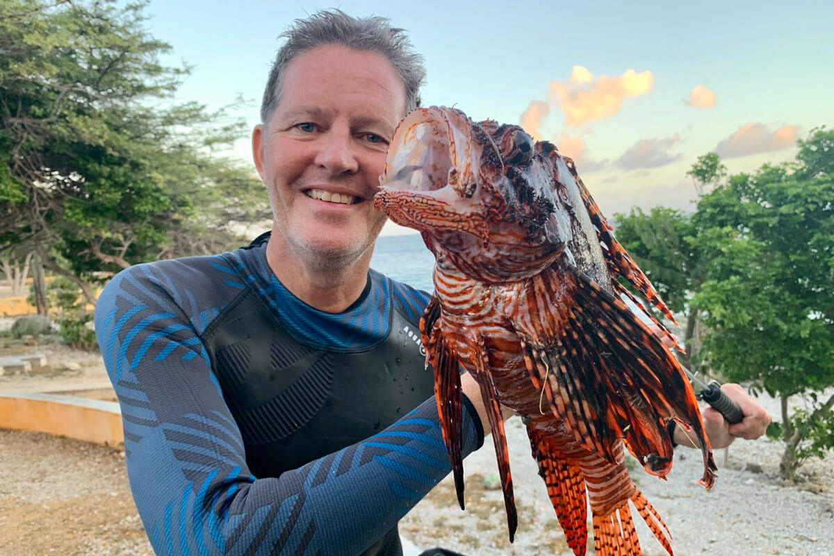 Roland Verbeek holding lionfish