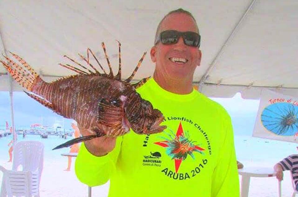 Ed Egan holding a lionfish