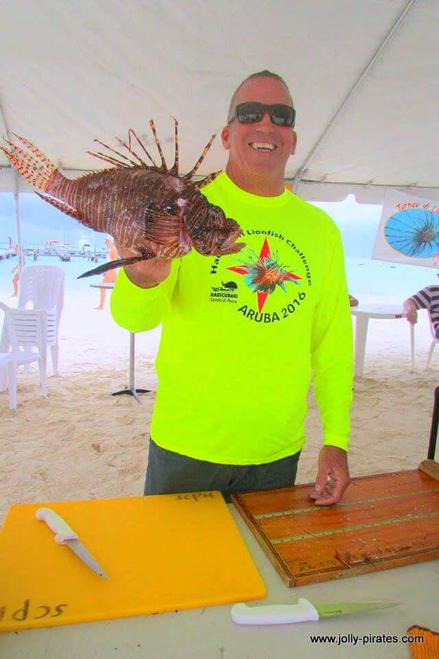 Ed Egan holding lionfish