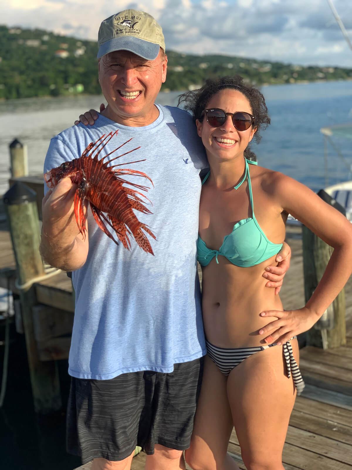 Kelsey M. Muller and Roger J. Muller, Jr. holding a lionfish
