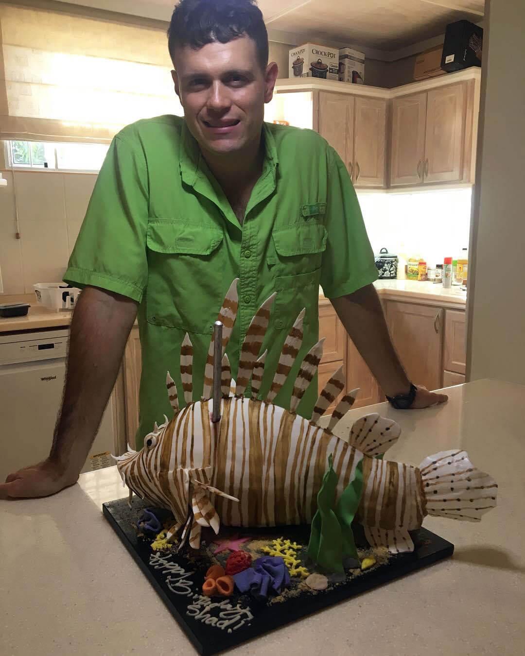 Shad Ferguson with lionfish birthday cake