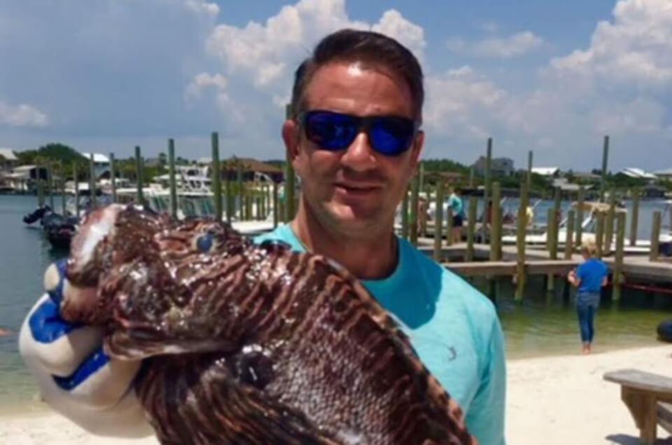 Houston George holding lionfish