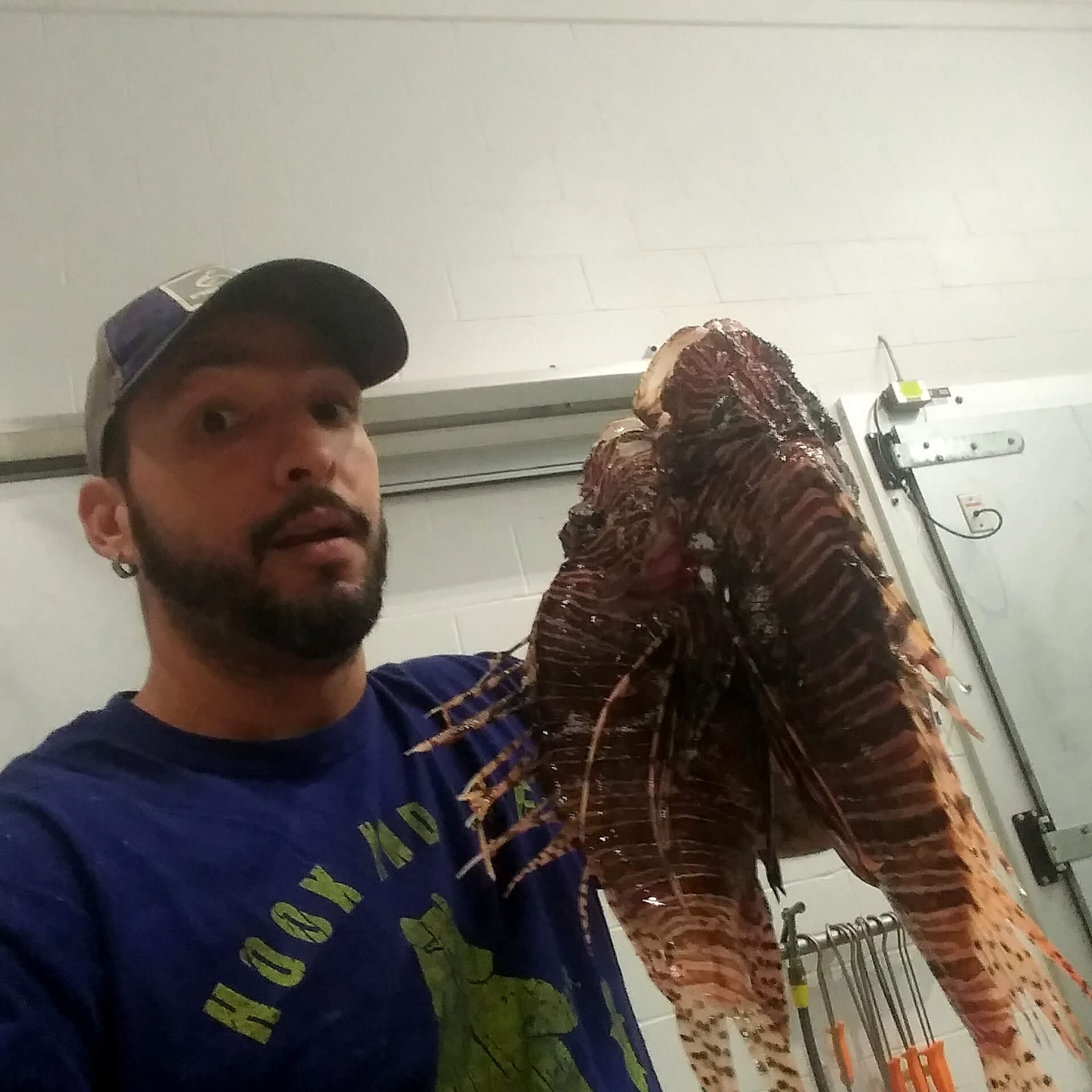 James Alicea holding a lionfish